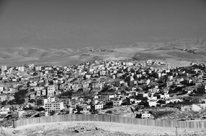 The Palestinian community of Abu Dis is separated from East Jerusalem by 36-foot tall concrete blocks. The Wall roughly runs along the East Jerusalem municipal district border and not the 1967 Armistice Line. © Morgan Hagar