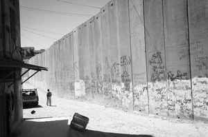 The Wall separating the Palestinian community of Abu Dis from East Jerusalem is constructed of 36-foot tall concrete blocks. © Morgan Hagar
