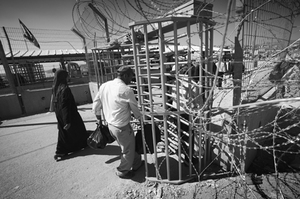 Installed in August, these turnstiles prevent Palestinian residents of nearby Qalandiya Refugee Camp and Ramallah from carrying large items through. Before installation, residents could freely walk through this section of the Qalandiya Checkpoint uninhibited. © Morgan Hagar