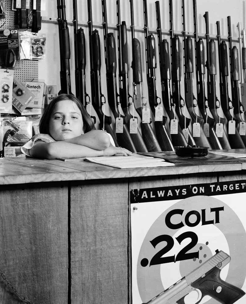 """I got a .410 shotgun from Santa Claus last year."" Sarah Read, 10, at her father's gun store."