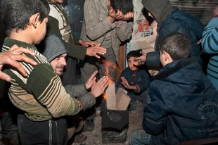 © Iva Zimova. Inhabitants of Aleppo try to warm themselves in a bitter winter.