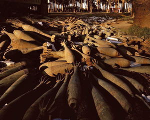 Abandoned mortar shells in a date grove in Atifya, northern Baghdad. Baghdad 19-27 April 2003. © Simon Norfolk