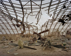 "Military hangars containing spares for planes and helicopters at Kabul Airport, destroyed by American bombs. From ""Forensic Traces of War"" © Simon Norfolk"