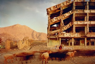 Bullet-scarred apartment building and shops in the Karte Char district of Kabul. This area saw fighting between Hikmetyar and Rabbani and then between Rabbani and the Hazaras  2003.
