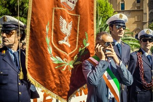 "PALERMO, ITALY Corrado Valvo, mayor of Noto in full dress uniform, demonstrates in front of the City Council in Palermo to protest the closing of Noto's hospital. He is surrounded by his city's local police, who back him. The ""gang-like"" image of this photo is misleading: they are not the evil ones in this situation. © Carlos Spottorno"