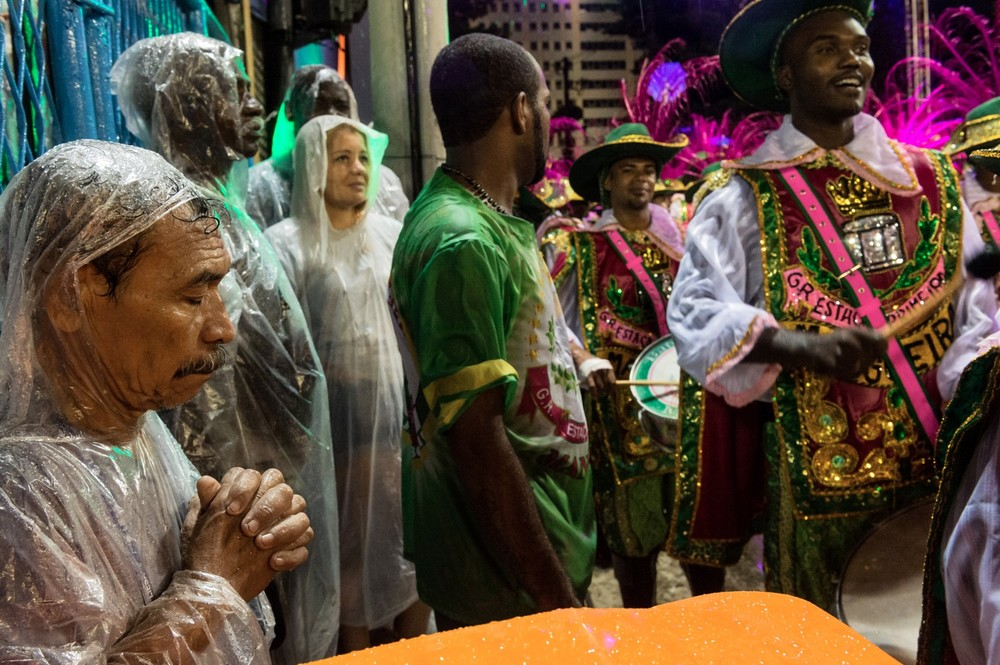A worker prays—he wants his school to win the 2015 Carnival parade.