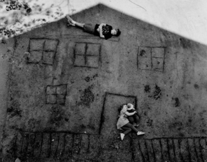 Laura and Brady in the Shadow of Our House, 1994 © Abelardo Morell