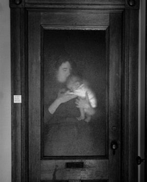 Lisa and Brady Behind Glass Door, 1986 © Abelardo Morell