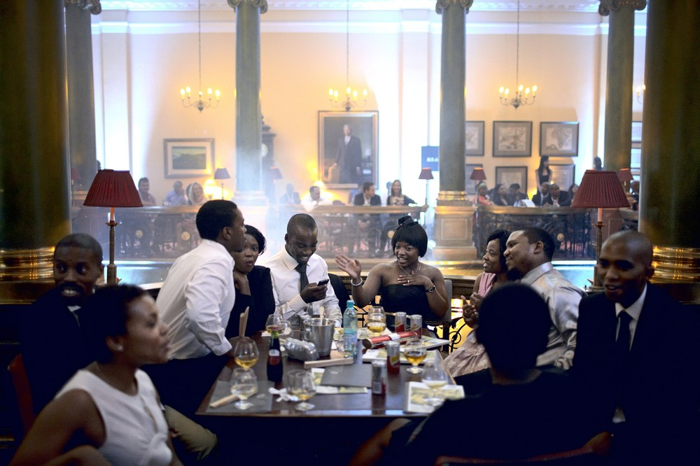 "Wealthy black South Africans at the Rand Club in central Johannesburg. The club opened in 1887 and was whites-only. Nowadays, it accepts women and members of all races. From the photobook ""Rainbow Transit"" © Per-Anders Pettersson"