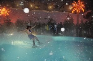 A skier takes part in a humorous competitions at Krasnaya Polyana ski resort, outside Sochi, on February 25, 2012. The goal of the competition is to move as far as possible on the water surface of a pool on an alpine skis.