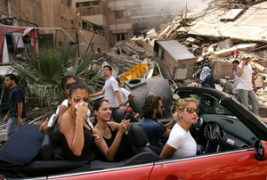 World Press Photo of the Year 2006, © Spencer Platt, USA, Getty Images, Young Lebanese drive through devastated neighborhood of South Beirut, 15 August