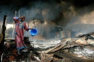 1st prize Spot News Singles, ©Akintunde Akinleye, Nigeria, Reuters, Man rinses soot from his face after gas pipeline explosion, Lagos, Nigeria, 26 December
