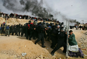 1st prize People in the News Singles, © Oded Balilty, Israel, The Associated Press, Settler woman struggles with Israeli security officer, Amona outpost, West Bank,1 February