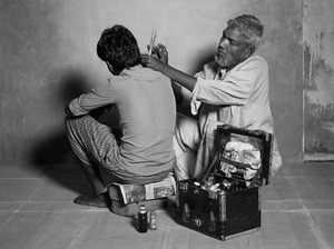 EAR-CLEANER & PERFUMER, $28 WEEKLY, 2011 © Supranav Dash