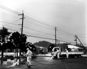 """The government approved a 10 billion euro budget for decontamination. Workers decontaminating the radioactive substances in Iitate village. Many say that decontamination is useless as it just moves or spreads the substances from one place to another. These workers don't receive any special training to protect themselves from the risky work. From the series """"Fragments/Fukushima"""" © Kosuke Okahara"""
