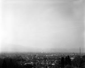 """A view of Fukushima city. Poplulation of 290,000. The city still faces the fear of radiation though people are getting tired of being cautious. Most people do not even wear a mask. From the series """"Fragments/Fukushima"""" © Kosuke Okahara"""