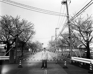 "Mr. Sanbe used to live right outside of the exclusion zone. He came to visit to see the cherry blossoms near his old house. From the series ""Fragments/Fukushima"" © Kosuke Okahara"