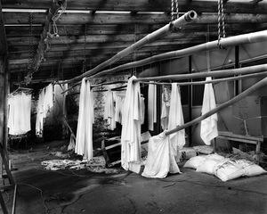 "Abandoned laundry in front of an abandoned hot spring spa. From the series ""Fragments/Fukushima"" © Kosuke Okahara"