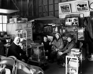 "A portrait of the Sanpei family at their new farm. They were forced to move their cow from the high radiation area which was 26km from the reactor. Still their relocated farm has 1 m sv/h. Their milk doesn't break any laws so they keep producing milk that is mostly used for ice cream. From the series ""Fragments/Fukushima"" © Kosuke Okahara"