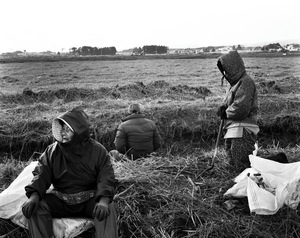 """Farmers of Minamisoma clean the farm land that was wiped out by the tsunami. However, it is uncertain if they can cultivate their farmland again not only because of the sea water but also the radioactive substances that contaminated the earth. From the series """"Fragments/Fukushima"""" © Kosuke Okahara"""