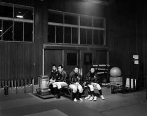 "Baseball players of Soma Noko high school practice inside the gymnasium in Minamisoma. After the decontamination of their baseball field, they started practicing outside, though the radiation level was still relatively higher than the so called ""Normal Level"". From the series ""Fragments/Fukushima"" © Kosuke Okahara"
