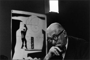 Le Corbusier, Paris, 1959. The architect in the private office of his studio, Atelier 35 S, built within a former monastery in the rue de Sèvres in Paris. In the background is the Modulor, a system of measurement used by Le Corbusier to achieve harmony in his architectural compositions. © René Burri / Magnum Photos