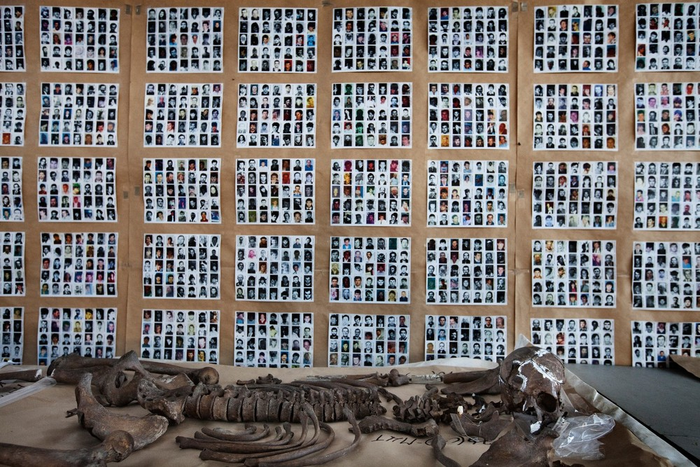 "Pictures of missing persons and already identified victims are displayed in the mortuary of Sanski Most in northwest Bosnia. From the series ""Where Do We Go From Here?"" © Ole Elfenkämper"