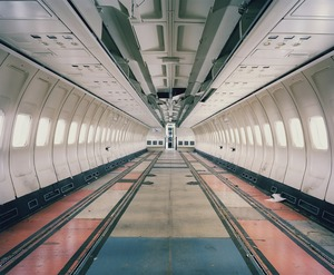 "A Boeing 727 has been stripped of its interiors while its seats undergo maintenance and their covers are replaced. From the series ""The LAB Project"" © Nick Ballon. Honorable Mention, 2013 LensCulture Exposure Awards"