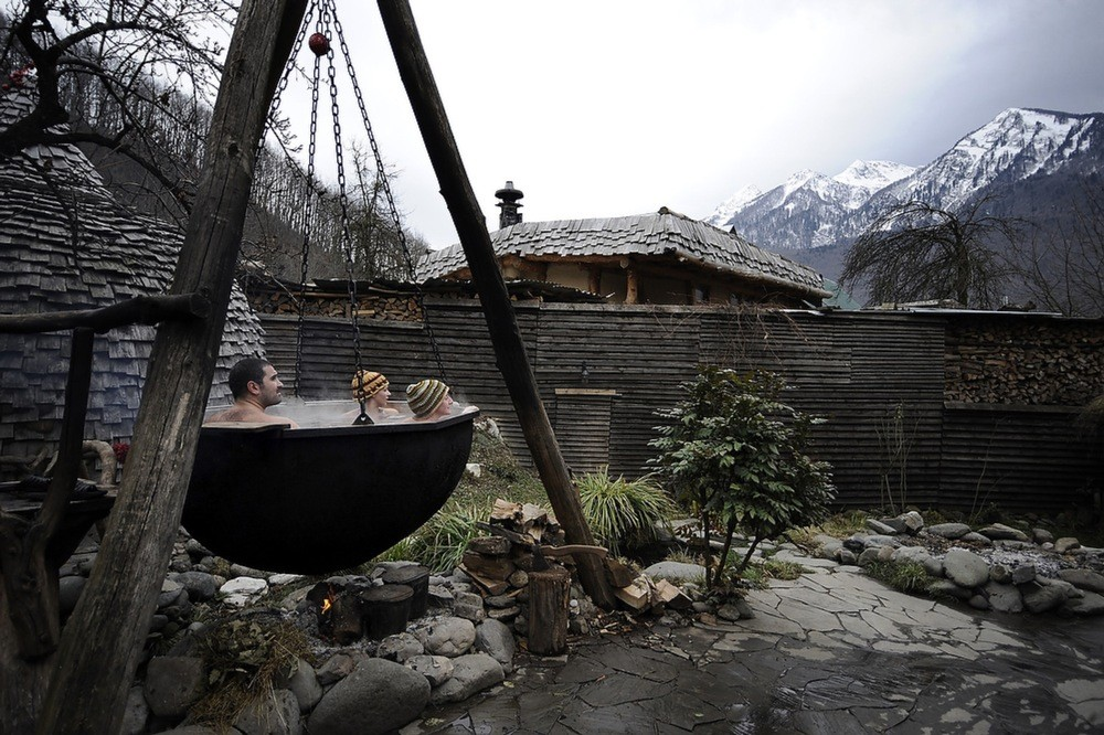 "Tourists warm themselves in a copper pot at the luxurious sauna complex, British Banya. From the series ""Sochi: A 100 Days Before the Olympic Games"" © Mikhail Mordasov"
