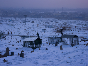 A Shia cemetery on the flanks of Kohe Asmai. © Simon Norfolk.