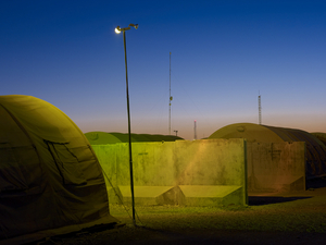 Security lights and communications antennae at Camp Leatherneck. © Simon Norfolk.