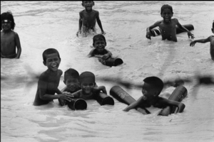 """Cambodia. Children swimming in the Mekong. 1974. From the book """"War Photographer: Between Shadow and Light"""" © Christine Spengler"""