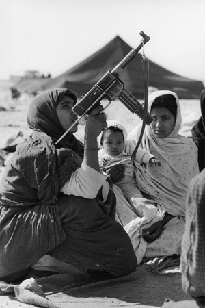 """The Western Sahara. Women in training. 1976. From the book """"War Photographer: Between Shadow and Light"""" © Christine Spengler"""