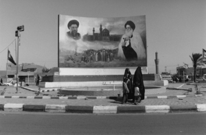 """Iraq. Entrance to the former Saddam City, Baghdad. 2003. From the book """"War Photographer: Between Shadow and Light"""" © Christine Spengler"""