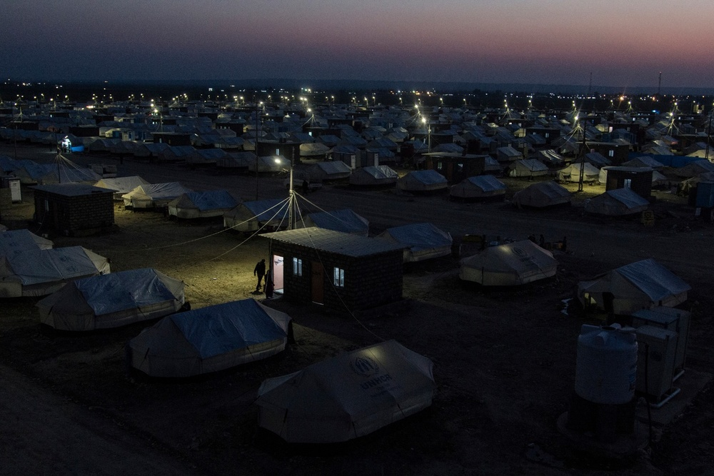 A view of the Laylan IDP camp at night. Laylan camp is 20 KM south of Kirkuk. UNHCR and the municipality of Kirkuk built the camp with around 1500 tents. Around 8450 people live in the camp. Metrography IDP project is funded by Free Press Unlimited 22/01/2015 -- Kirkuk, Iraq