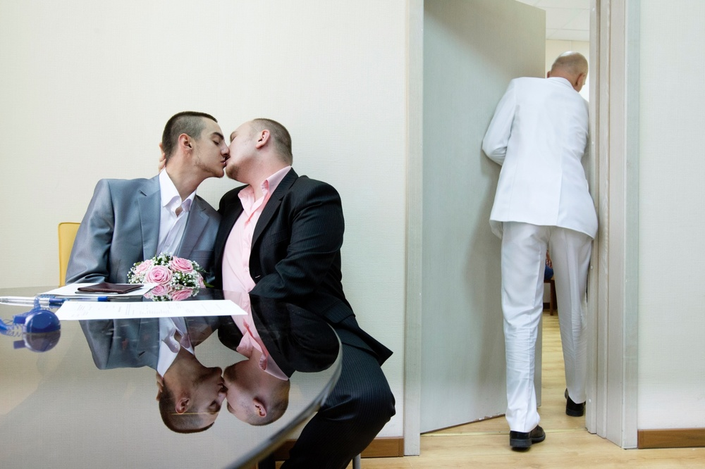 Yaroslav Yevtushenko (left) embraces his boyfriend Dmitry Chunosov. Yaroslav embraces his boyfriend at St. Petersburg's registry office where the couple is attempting to officially register their marriage. Since same-sex marriages are not recognised in Russia, their submission was promptly rejected by the authorities. They knew this would happen—it was an act of protest.
