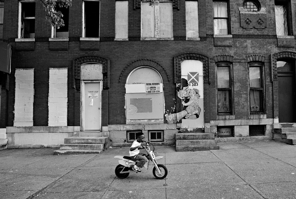 A young child testing his electric motorcycle during the days of protest. Baltimore, MD.