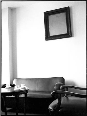 Tito's image removed, bureaucrat's office, Belgrade, 1992, © Sylvia Plachy