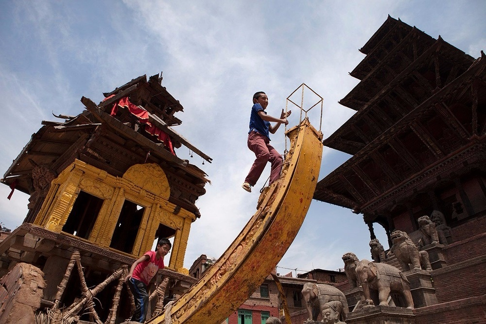 Children play on a broken temple in Bhaktapur, Nepal on 5 May 2015.