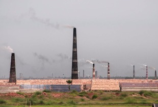 Landscape view of brick making fields emiting tremendous amount of carbon dioxide in Bangladesh.