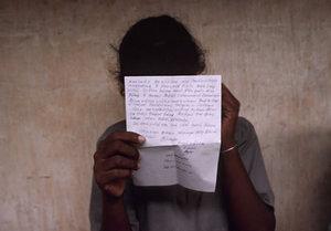 Uma reads a letter from home at the Methsevana Government Rehabilitation Center for Girls in Nugegoda, Sri Lanka, 1999. Country: Sri Lanka, Born: 1982 Served: Liberation Tigers of Tamil Eelam, Conflict: Tamil Insurgency (Sri Lanka Civil War) 1983-2003. © Lori Grinker, courtesy of Nailya Alexander Gallery