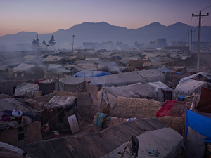 Historically, Kuchis were strongly pro-Taliban; feelings made more intense by being bombed by NATO off their traditional grazing lands in Helmand. They are allowed to set up camp here on Kabuls periphery only because it is below a large, new Afghan Army base. © Simon Norfolk.