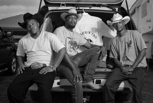 L-R Quentin Welch Jr., Rico Welch, DT Welch. Quentin and DT work for Rico on his horse farm near Talladega, Alabama. They were photographed when they attended a rodeo in Birmingham, AL on June 27, 2015.