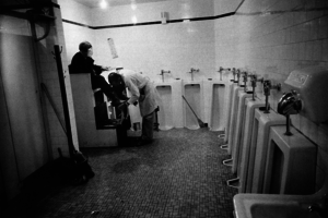 Men's room, railway station. From The Americans