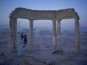 Jaw Aka Faizal Nahman and his daughter Nono from Bamiyan province, now living in an improvised plastic shelter in the ruined gardens of Darulaman Palace. Built in the 1920s to house an Afghan parliament, Darul Aman translates as abode of peace.© Simon Norfolk.