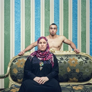 Why is the image of the mother?son relationship so powerful? Because the son, by his nudity, looks as fragile as he was on the day of his birth? Because the mother seems fulfilled by the presence of son, who completes her? © Denis Dailleux, France. Shortlist, People, Professional competition. 2014 Sony World Photography Awards