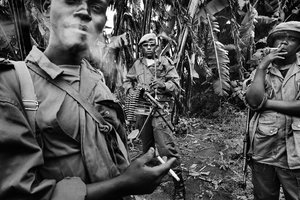Soldiers of General Mathieu Ngodjolo, leader of the MRC (Movement for the Revolution of Congo) militia, in their stronghold of Zumbe. The militia, like their government-soldier counterparts, have been accused by Human Rights Watch of using rape as a weapon of war. 2006.