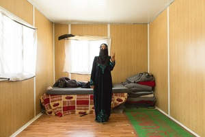 Fahima only recently moved into this prefab. She and her children fled to Jordan without her husband who stayed behind in Syria. She fled with her children during the night and had to drug them with cough medicine for the fear of being discovered if the children started to cry. She said it was terrifying, they could hear gun fire while they tried to make their way to safety © David Brunetti
