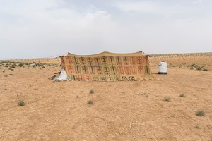 A tent in an impromptu camp at the outskirts of Azraq. Most families have pitched tents they took when they left Zaatari but some hadn't been to the refugee camp and had to scrape whatever materials were available to build shelter. © David Brunetti