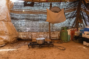 The kitchen area in a make-shift tent in an informal encampment in Neaime. With a dirt floor and made of whatever material was available the tent doesn't provide any protection against the weather, the cold or heat. © David Brunetti